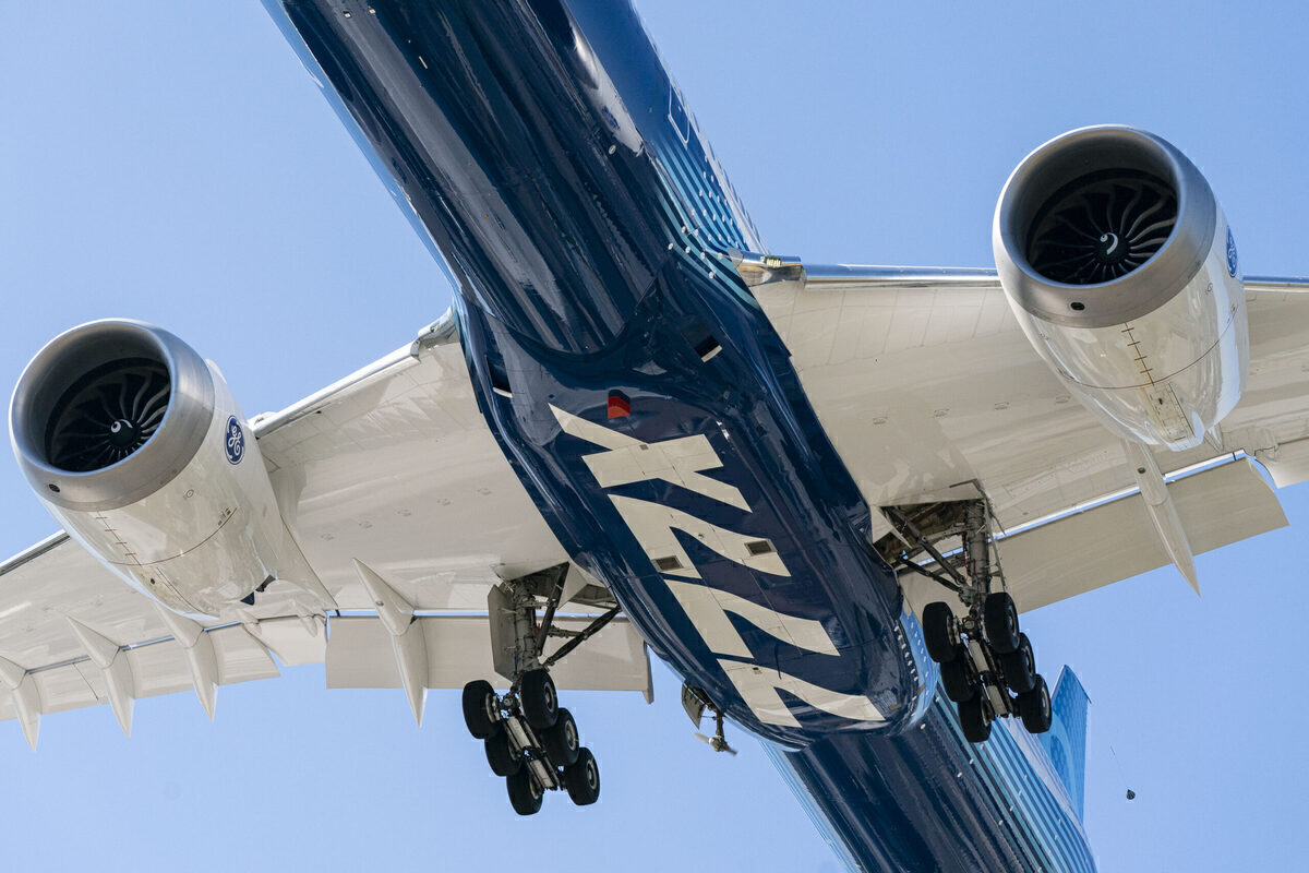 Bottom up shot of a Boeing 777X passing overhead