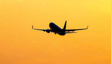 Silhouette Of A Departing Aircraft During Sunset