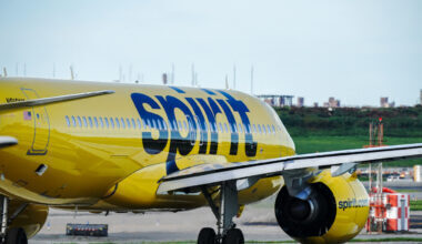 A Spirit Airlines aircraft takes off at La Guardia Airport