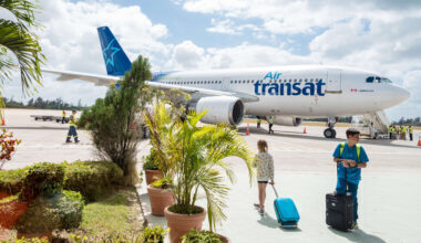 Passangers getting ready to board the Air Transat airplane