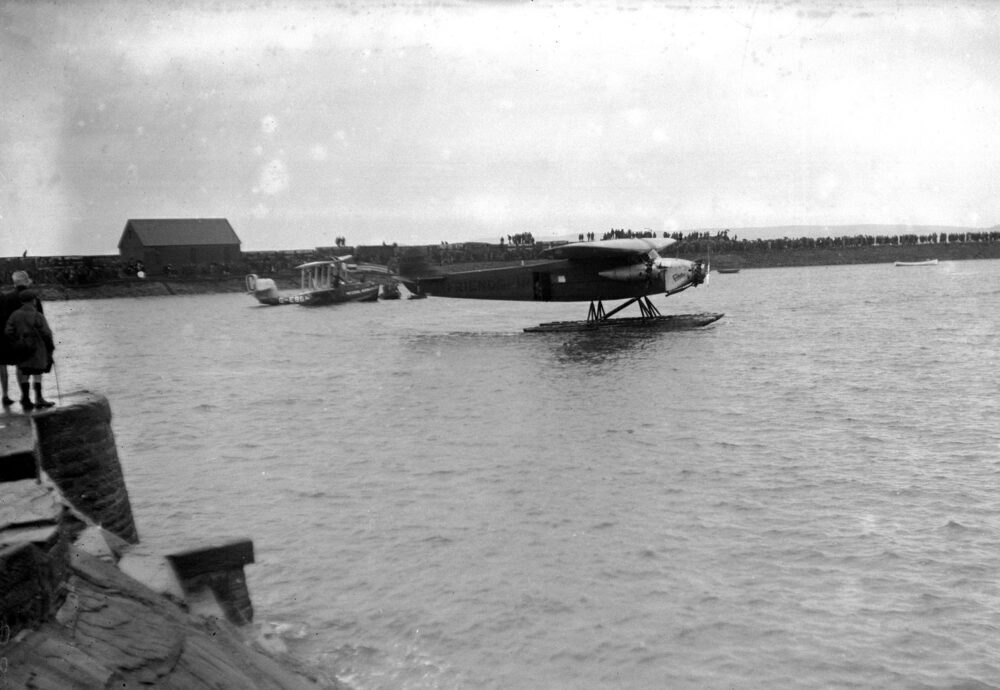 """Amelia Earhart flies the Atlantic. OPS """"The Friendship"""", a triple engined Fokker she used for the flight anchored at Bur"""