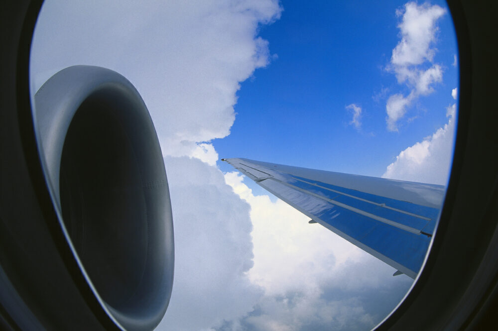 Rolls-Royce BR-715 engine-intake and trailing-edge of the wing of a Boeing 717-200 flying through clouds during the 1999 Paris-Airshow