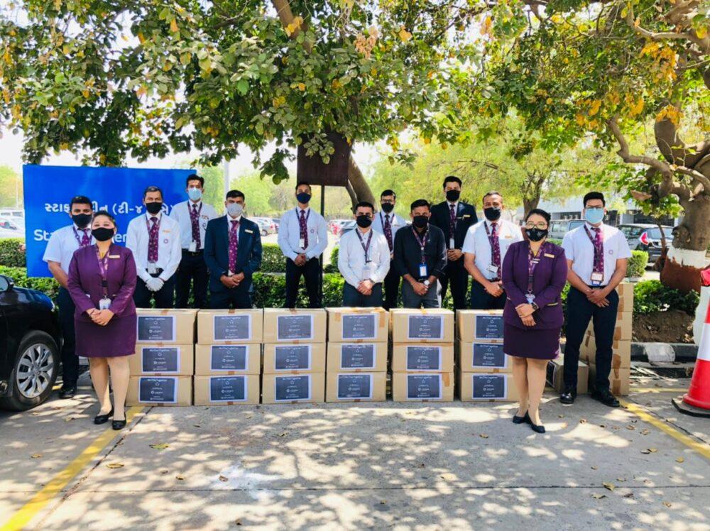 Vistara Staff Distributing Wellness Kits
