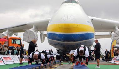 Ukrainian strongmen pull An-225 Mriya plane