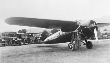 Amelia Earhart Posing Beside Plane