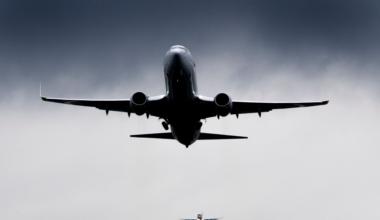 generic airplane in cloud weather turbulence rain storm