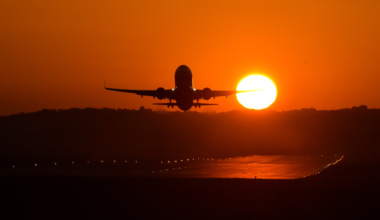 A plane seen taking off during sunset at Krakow's Balice